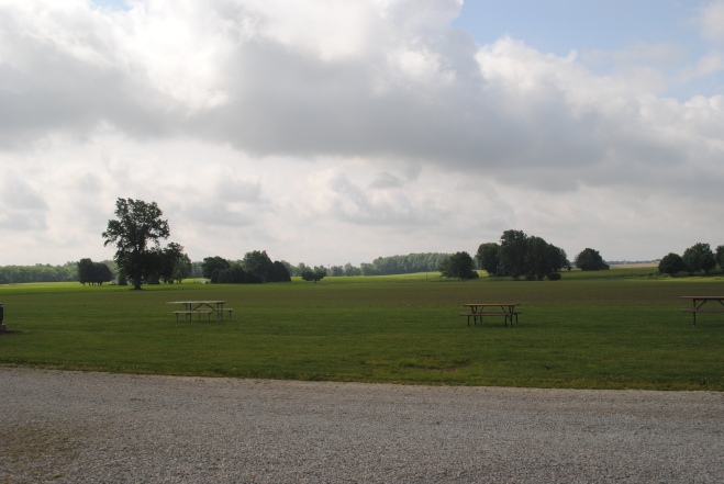 Open fields surround the campsite