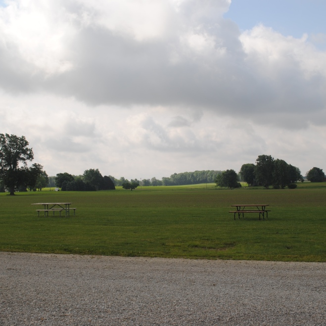 Open fields surround the campsite